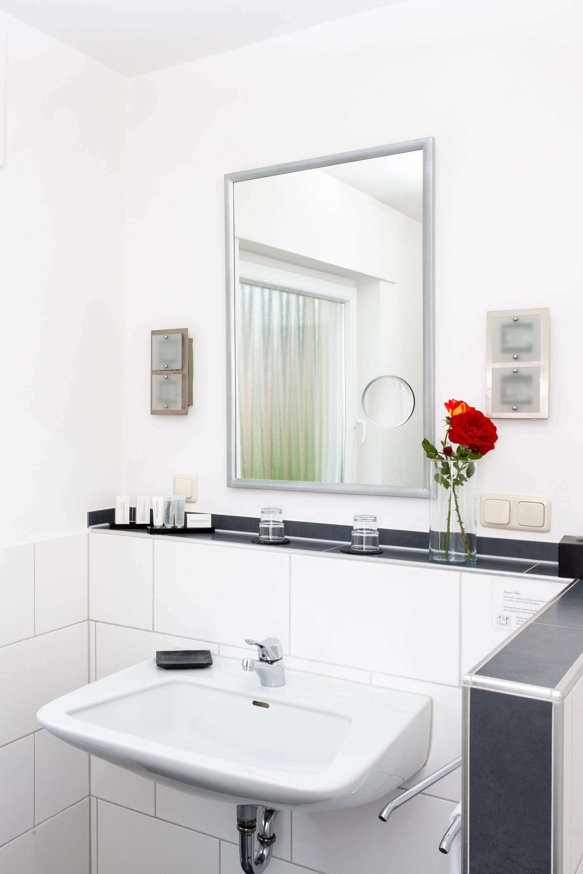 Hotel bathroom with mirror and sink